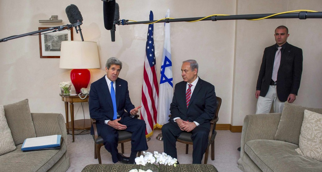 Secretary of State John Kerry (L) speaks during his meeting with Israel's Prime Minister Binyamin Netanyahu in Yerushalayim on Tuesday. (REUTERS)