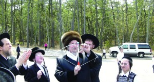 Harav Rafael Goldstein, Skolya Rebbe, shoots a bow and arrow in Lakewood on Sunday.
