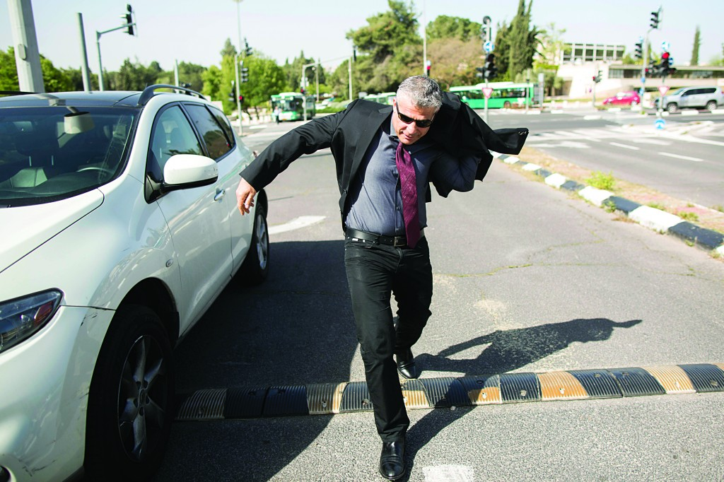 Finance Minister Yair Lapid arrives at the weekly Cabinet meeting on Sunday. (Flash90)