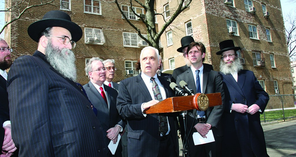 Assemblyman Joe Lentol speaking at a news conference on Tuesday related to the dozen mezuzah burnings in Williamsburg. At left is Rabbi Moshe Dovid Niederman and Scott Stringer, second from right is Councilman Steve Levin. (Shimon Gifter)