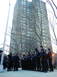 Police officers gather outside the Taylor Street building on Tuesday where the charred remains of a mezuzah were discovered. (JDN)