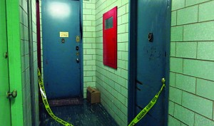 Two doorways are cordoned off with crime scene tape inside the Taylor Street building Tuesday, where the charred remains of a mezuzah were discovered. (JDN)