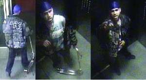 A video grab from a surveillance camera released by police, depicting Rubin Ublies as he lights a match outside a Clymer Street building Tuesday. (NYPD)