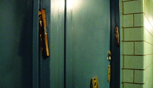 Burned mezuzah cases hang on the doorway inside a Taylor Street complex on Tuesday. (JDN)