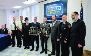 (R-L) Rabbi Yanky Meyer of Misaskim, unidentified, Councilman David Greenfield, Fire Commissioner Salvatore Cassano, Brooklyn South Fire Chief James Leonard and the Horodenke Rav. The two on the far left are also unidentified.