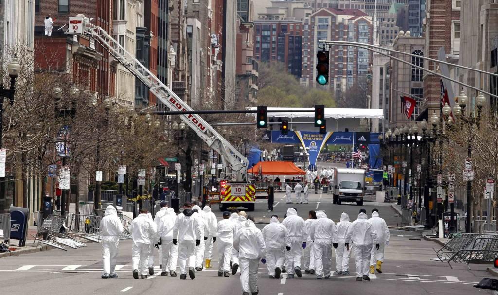 Law enforcement evidence technicians continue to investigate the scene of the Boston Marathon bombings in Boston. (REUTERS/Jim Bourg)