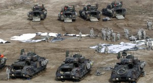U.S. Army soldiers prepare for an exercise during their annual military drills with South Korea, in Yeoncheon, South Korea, near the border with North Korea, Tuesday. (AP Photo/Ahn Young-joon)