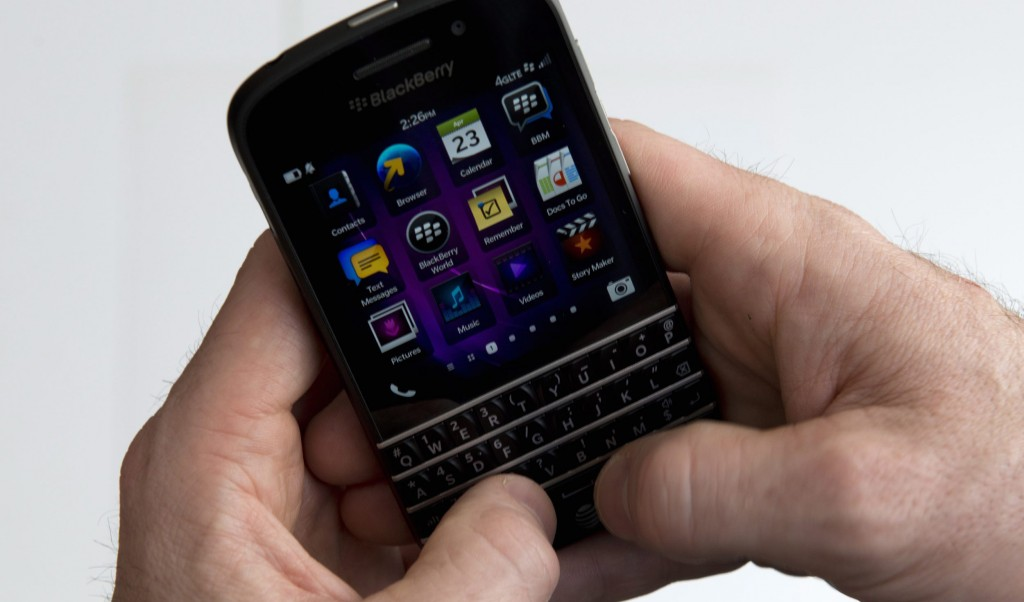 A BlackBerry Q10 smartphone is displayed in Toronto on Tuesday. In the Q10, the keyboard and touchscreen work together. (AP Photo/The Canadian Press, Graeme Roy)