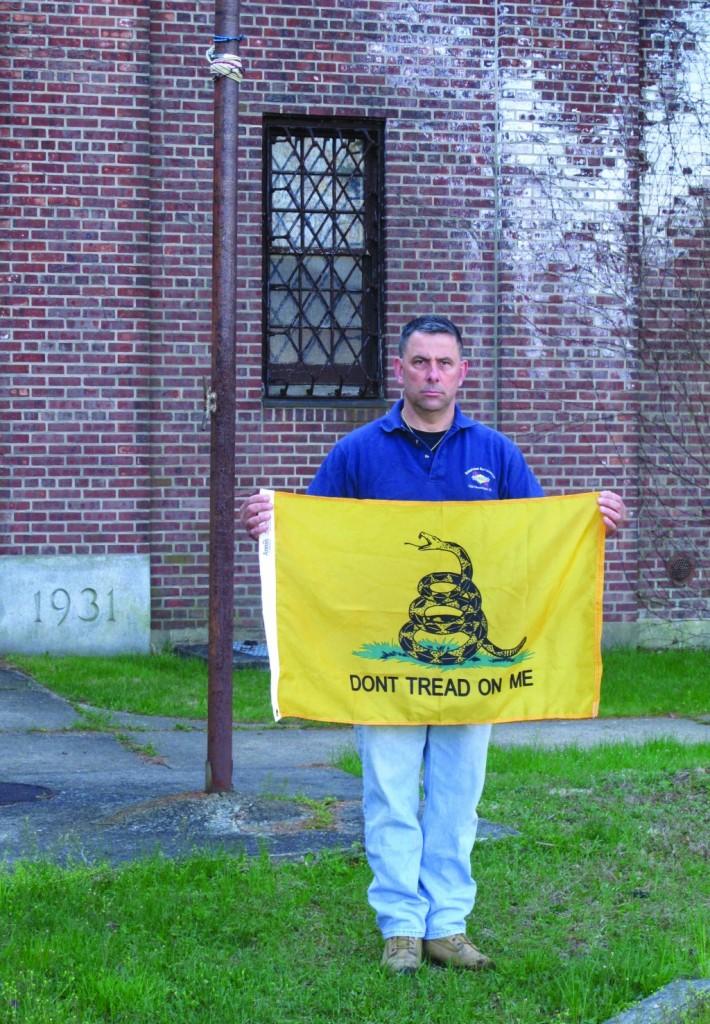 A Gadsden flag outside an armory in New Rochelle, N.Y. (AP Photo/Jim Fitzgerald)