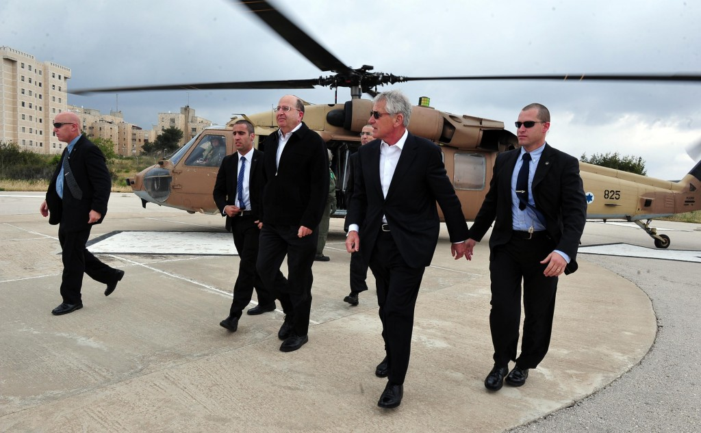 U.S. Secretary of Defense Chuck Hagel (2nd R) walks with Israeli Minister of Defense Moshe Yaalon (3rd L) on a landing pad after a helicopter tour of the Golan Heights on Monday. (FLASH90)