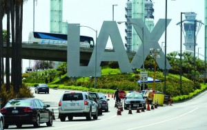 Cars stop at a checkpoint at the entrance of Los Angeles International Airport after security was increased.