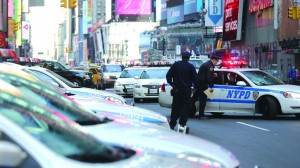 NYPD officers gather at the edge of Times Square. The city implemented heightened security measures in response to Boston's bombings.