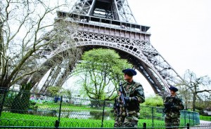 French soldiers patrol in front of the Eiffel Tower in Paris.