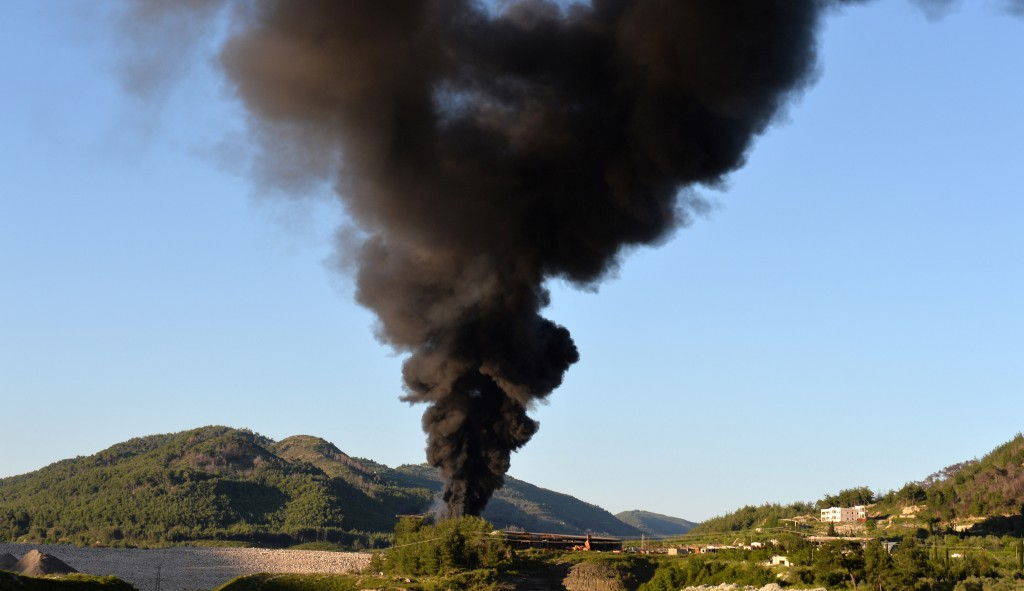 Smoke rises after shelling on al-Turkman mountains in the Latakia province, western Syria on April 25. The White House said that Syria had likely used chemical weapons against rebel forces on a 'small scale,' but emphasized US spy agencies were still not 100 percent sure of the assessment. (MIGUEL MEDINA/AFP/Getty Images)