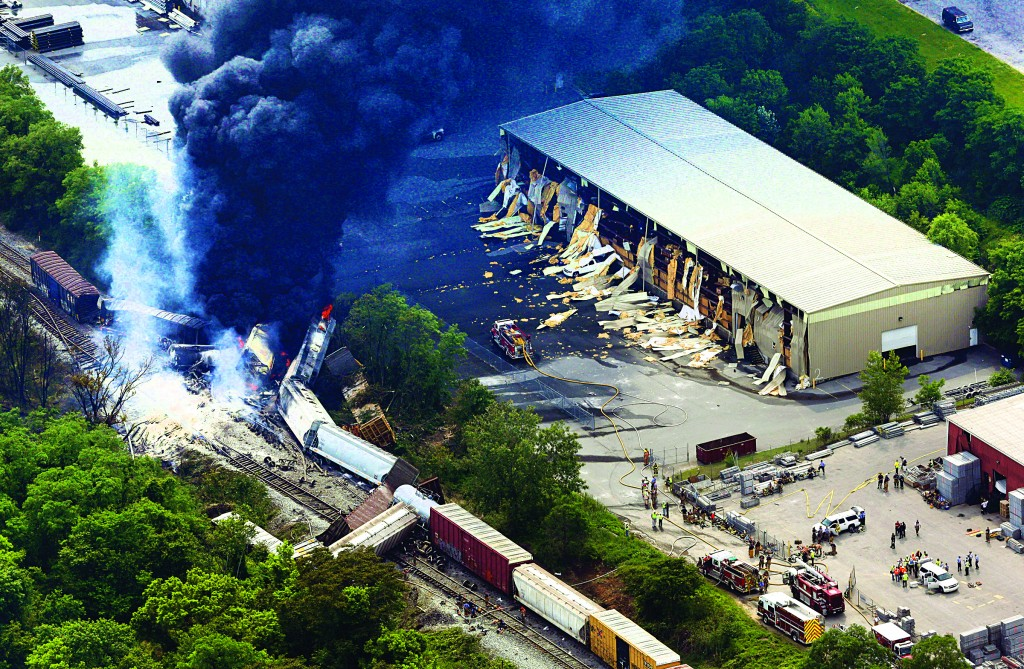 A fire burns at the site of a CSX freight train derailment, Tuesday, in White Marsh, Md., where fire officials say the train crashed into a trash truck, causing an explosion that rattled homes and collapsed buildings over a half-mile away.(AP Photo/Patrick Semansky)