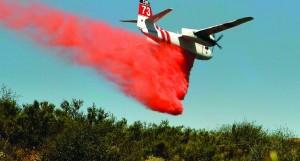 A firefighting aircraft drops fire retardant along a hillside near Thousand Oaks, Calif., on Thursday. (AP Photo/Nick Ut)