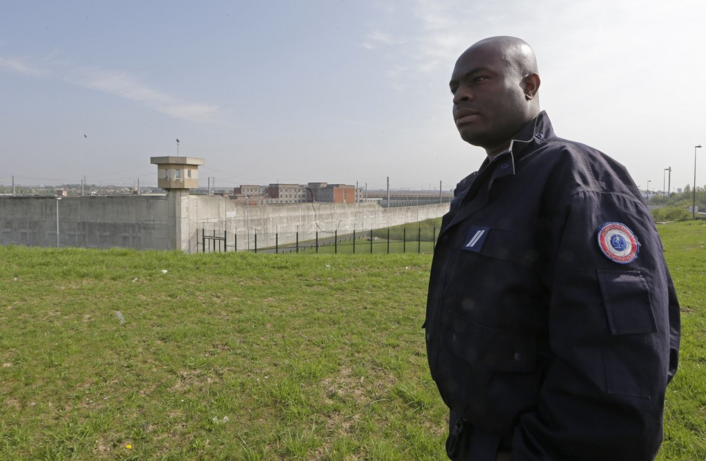 """Villepinte prison guard Blaise Gangbazo walks on grounds overlooking the prison facilities in Villepinte. Noisy, dirty and smelling of garbage, Villepinte is the most crowded jail in the Paris region and is dubbed the """"jungle"""" by guards. (REUTERS/Jacky Naegelen)"""