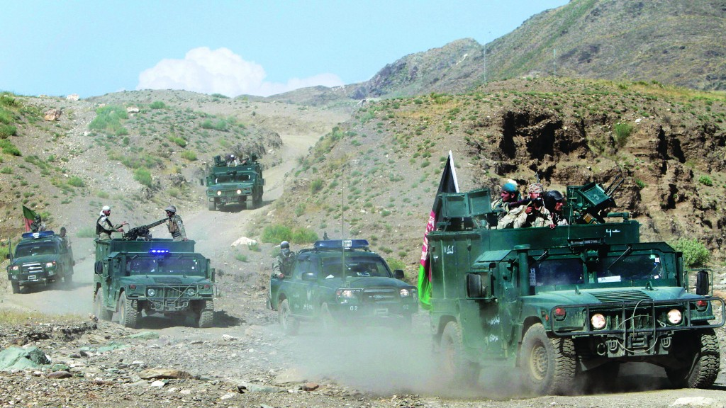 Afghan border policemen arrive at the border between Afghanistan and Pakistan in the Goshta district of Jalalabad province east of Kabul, Afghanistan, Thursday. Border incidents have escalated dramatically during the past two weeks. (AP Photo/Rahmat Gul)