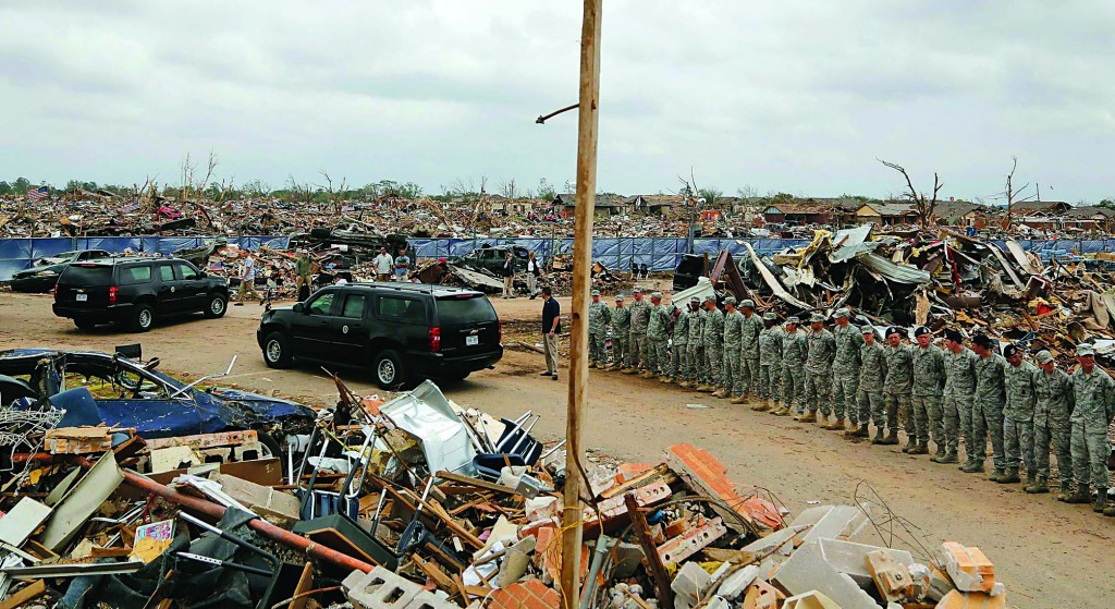 A line of National Guardsmen stand near President Barack Obama's motorcade as he tours tornado damage in Moore, Oklahoma, Sunday. (REUTERS/Jonathan Ernst)