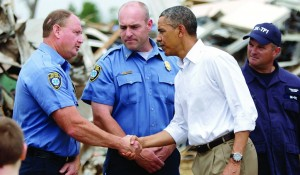 President Barack Obama greets first responders at the scene of tornado damage in Moore, Oklahoma, Sunday. (REUTERS/Jonathan Ernst)