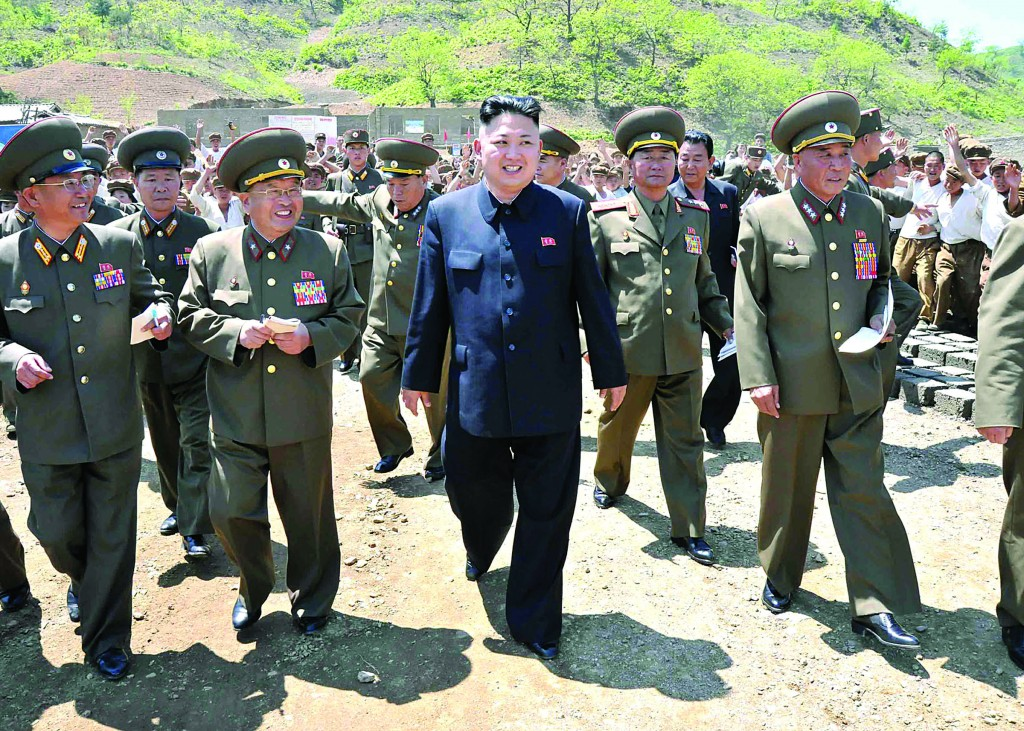 In this undated photo released by the Korean Central News Agency (KCNA) and distributed Tuesday, by the Korea News Service (KNS) in Tokyo, North Korean leader Kim Jong Un, center, visits the Breeding Station No. 621 of the Korean People's Army under construction at an undisclosed location of North Korea. (AP Photo/KCNA via KNS)