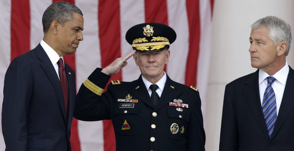 (L-R): President Barack Obama is greeted by Chairman of the Joint Chiefs of Staff U.S. Army General Martin Dempsey and Defense Secretary Chuck Hagel as he takes the stage for remarks at the Memorial Day observances at Arlington National Cemetery in Arlington, Virginia, Monday. (REUTERS/Jonathan Ernst)