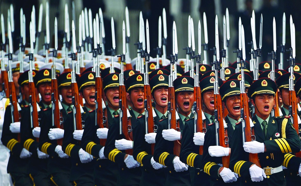 Honour guard troops march during at a ceremony outside the Great Hall of the People in Beijing, Sunday. (REUTERS/Petar Kujundzic)