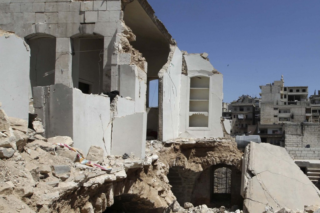 A general view shows buildings damaged by what activists said were missiles fired by Syrian Air Force fighter jets loyal to President Bashar al-Assad in Salqin city, Idlib governate, Tuesday.(REUTERS/Muzaffar Salman)