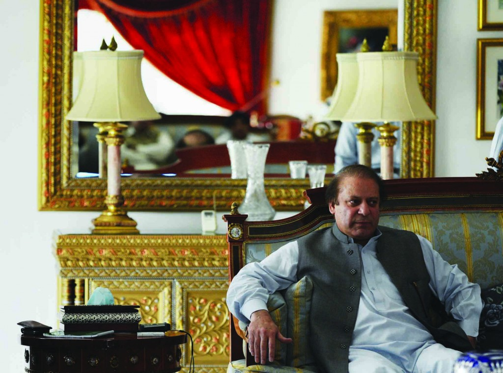Former prime minister and leader of Pakistan Muslim League-N party, Nawaz Sharif, speaking to members of the media at his residence in Lahore, Pakistan, Monday. (AP Photo/K.M. Chaudary)