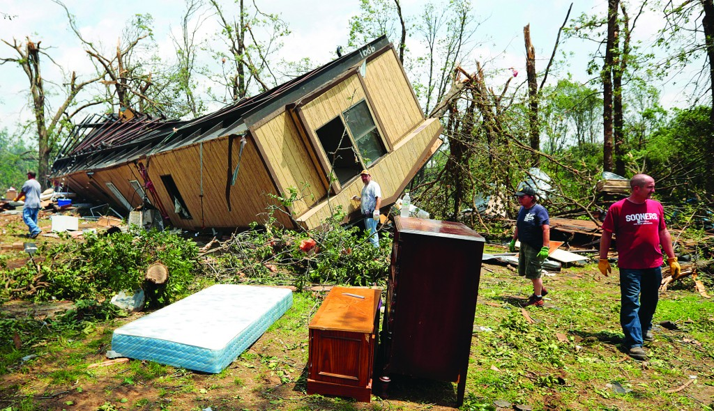 Volunteers help clean out Jean McAdams' mobile home after it was overturned by a tornado May 20, 2013, near Shawnee, Oklahoma. (Brett Deering/Getty Images)