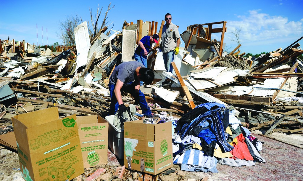 People go through the debris of their tornado-devastated homes looking for salvageable stuffs on May 22, 2013 in Moore, Oklahoma. As rescue efforts in Oklahoma wound down, residents turned to the daunting task of rebuilding a community shattered by a vast tornado.(JEWEL SAMAD/AFP/Getty Images)