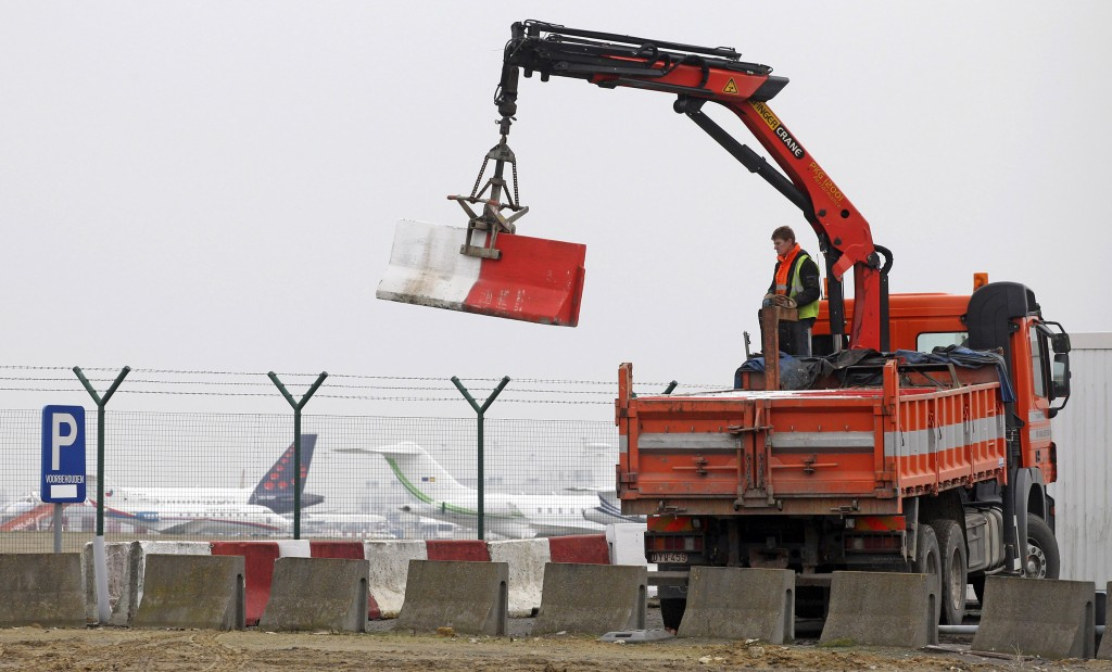 AP Photo/Yves Logghe, file In this Feb. 19, 2013 photo workers place concrete blocks to block access to a security fence next to the tarmac at Brussels international airport.