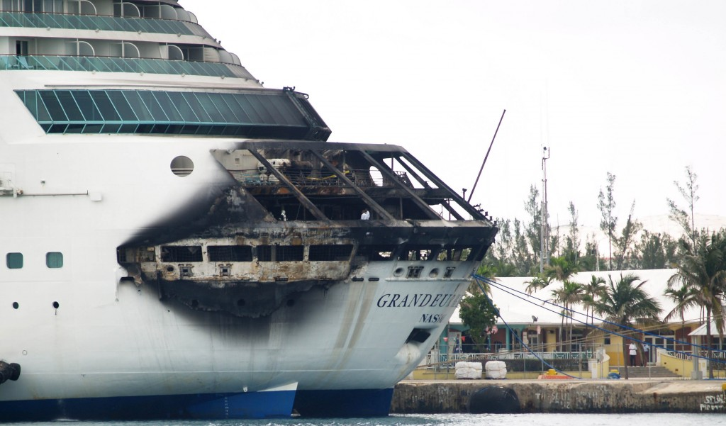 The fire-damaged exterior of Royal Caribbean's Grandeur of the Seas cruise ship is seen while docked in Freeport, Grand Bahama Island, Monday(AP Photo/The Freeport News, Jenneva Russell).