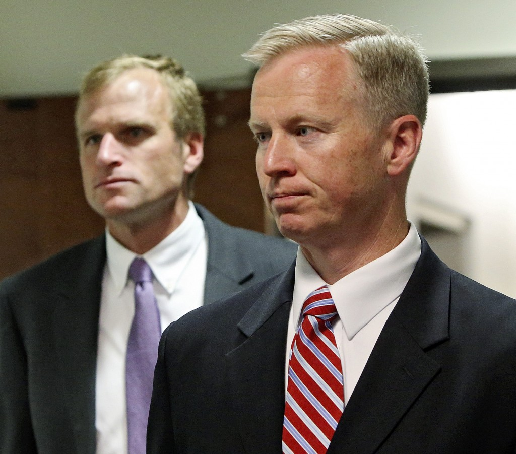 District Attorney George Brauchler, right, and Assistant District Attorney Mark Hurlbert arrive for a hearing in Centennial, Colo., where Aurora theater shooting suspect James Holmes asked a judge to enter a plea of not guilty by reason of insanity, in Centennial, Colo., on Monday. (AP Photo/Ed Andrieski)