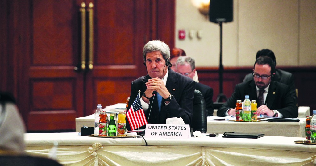 Secretary of State John Kerry listens to the speakers during the meeting of the friends of Syria conference, in Amman, Jordan, Wednesday(AP Photo/Mohammad Hannon)