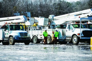 A power company crew surveys a downed tree that brought down power lines in a residential neighborhood near Emory University during a winter storm  (AP Photo/David Tulis)