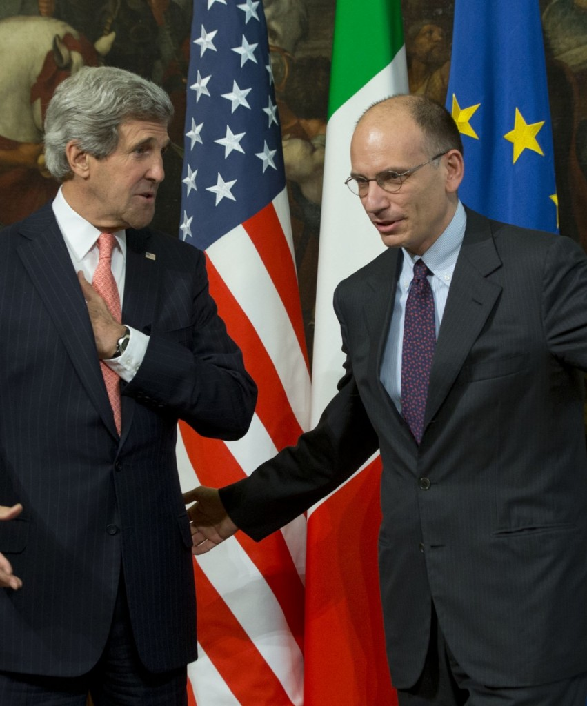 Secretary of State John Kerry (L) is greeted by Italian Premier Enrico Letta, upon his arrival at Rome's Chigi government palace, Thursday. (AP Photo/Andrew Medichini)