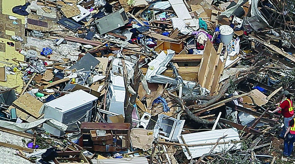 Rescue workers search a home after it was left flattened by a tornado in this aerial photograph taken over Granbury, Texas, Thursday. (REUTERS/Brandon Wade)