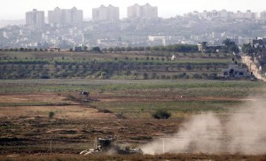 An Israeli APC patrols just outside the border with the Gaza Strip, Thursday.  (REUTERS/ Amir Cohen)