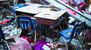 Desks for students sit with the roof collapsed on them at the site of tornado-damaged Briarwood elementary school in Oklahoma City, Oklahoma. No students were killed at this school.(REUTERS/Rick Wilking)