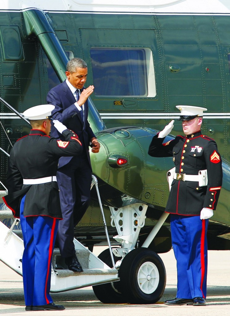 President Barack Obama steps off Marine One upon arrival to Andrews Air Force Base, Md., Wednesday. Obama is traveling to Chicago for two fundraisers to raise money for the Democratic Congressional Campaign Committee.(AP Photo/Jose Luis Magana)