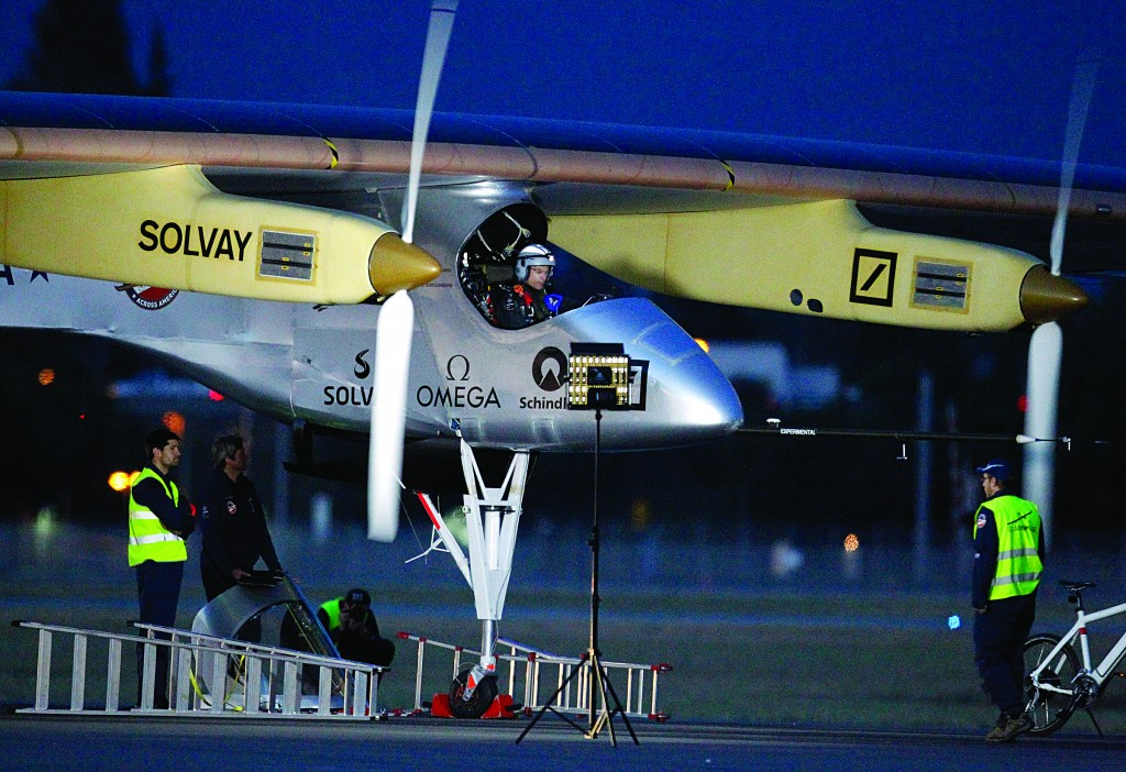 Bertrand Piccard, pilot of the Solar Impulse plane, prepares to take off on a multi-city trip across the United States from Moffett Field NASA Ames Research Center in Mountain View, Calif., on Friday. (AP Photo/Tony Avelar)