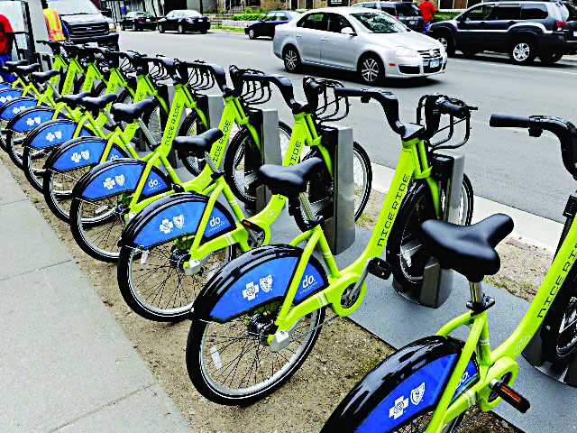 A row of bikes is lined up in Manhattan on Sunday as the city's bike-sharing program it unveiled.