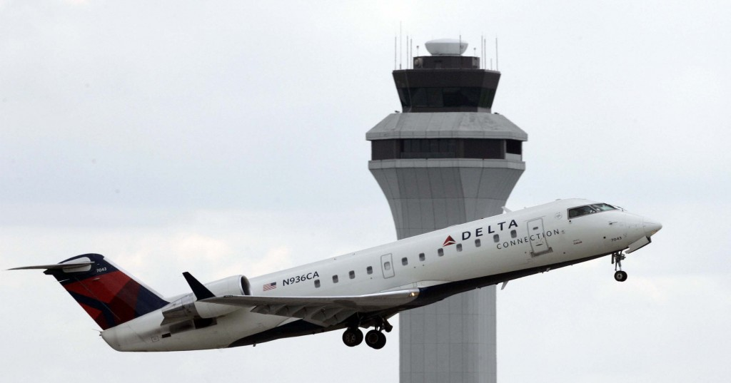 A Delta Connection jet takes off at the Greater Cincinnati Northern Kentucky International Airport in Hebron, Ky. (AP Photo/Al Behrman, File)