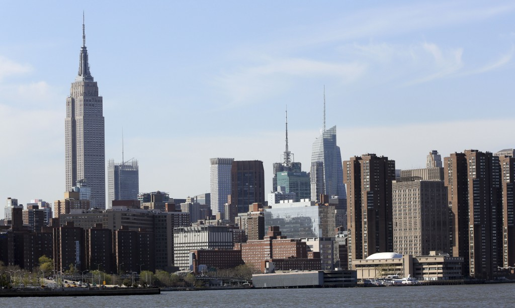 This Tuesday, April 30, 2013 photo shows New York's Empire State Building, left, in midtown Manhattan. (AP Photo/Mary Altaffer)