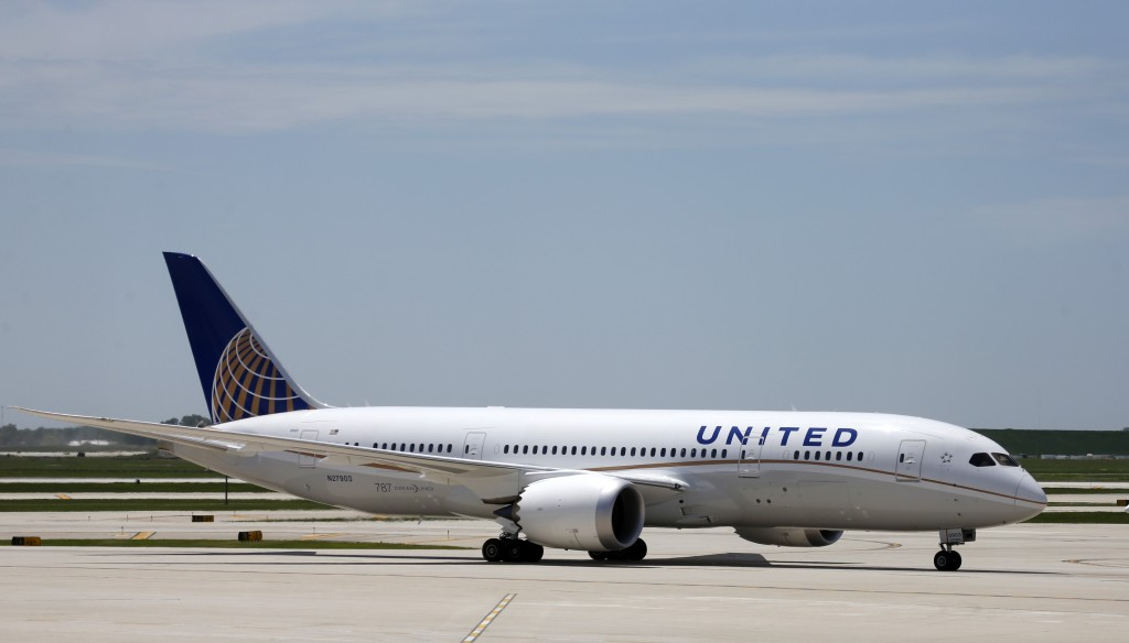 United Airlines Flight # 1, a Boeing 787 Dreamliner aircraft from Houston, Texas, taxis to the gate after landing at Chicago's O'Hare International Airport Monday. (AP Photo/Charles Rex Arbogast)
