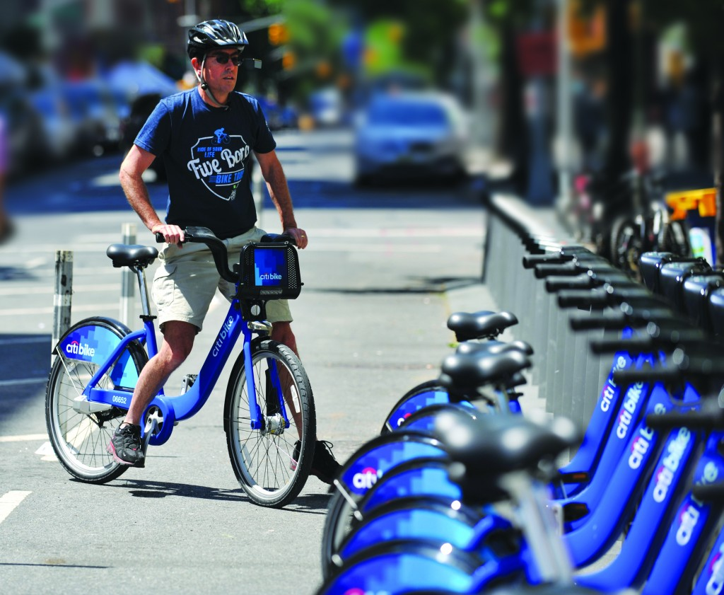 A man returns his Citi Bike bicycle to a station near Union Square on Monday as the bike sharing system begins in New York.(Stan Honda/AFP/Getty Images)