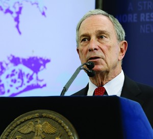 Mayor Michael Bloomberg speaks while a map of the projected 2050s 100-year flood plain of New York City is displayed on Tuesday.(AP Photo/Seth Wenig)