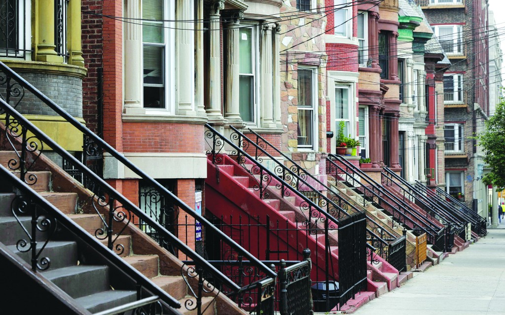 Manicured homes line a street in the Longwood historic district in the Bronx, Wednesday. AP Photo/Richard Drew