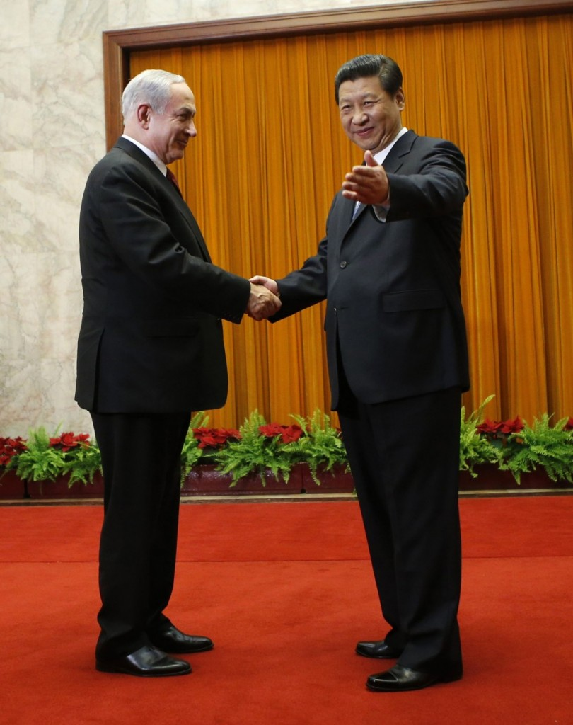 China's President Xi Jinping (R) shakes hands with Israel's Prime Minister Binyamin Netanyahu in the Great Hall of the People in Beijing on Thursday. (REUTERS)